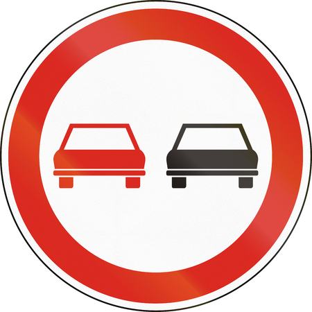 two objects: Hungarian regulatory road sign - No overtaking.