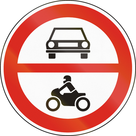 Road sign used in Hungary - No motor-driven vehicles. Stock Photo