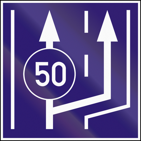 marking up: Informatory Hungarian road sign - Beginning of two lanes with minimum speed. Stock Photo