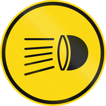 switch on: Temporary road sign used in the African country of Botswana - Switch headlamps on. Stock Photo