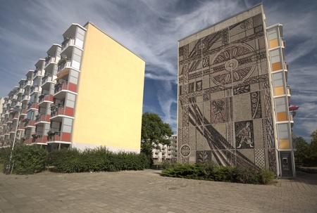lps: GREIFSWALD, GERMANY - SEP 09 2016 : East-German Plattenbauten in Greifswald with wall decoration by the artist Helmut Maletzke, created in 1959.