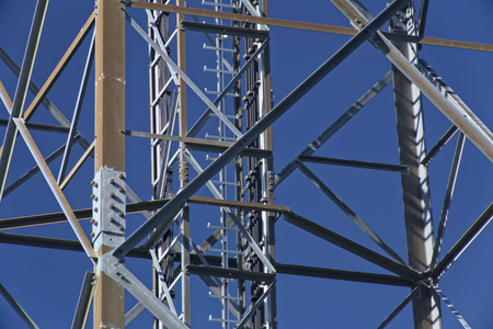 greifswald: Metal frame of telecommunications tower in front of a dark blue sky.