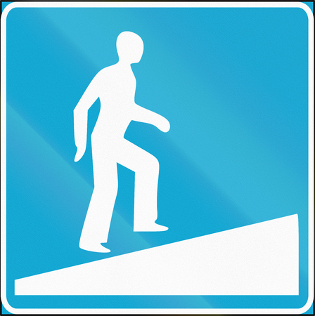 underpass: Road sign used in Estonia - Pedestrian underpass with ramp. Stock Photo