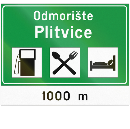 fork in the road: Information road sign used in Croatia - Odmoriste means lay-by.