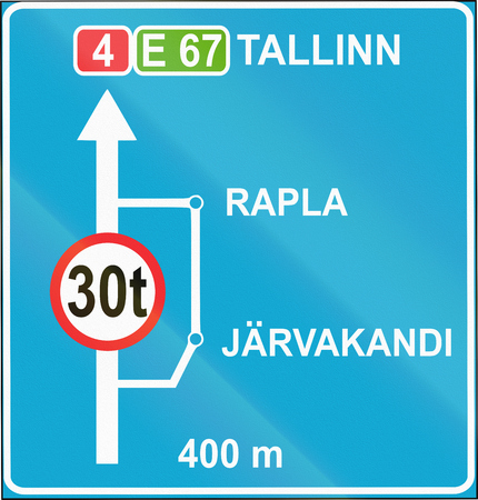 Estonian informatory road sign with bypass for trucks.