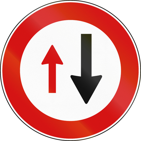 Road sign used in Malta - Priority of oncoming traffic. Stock Photo