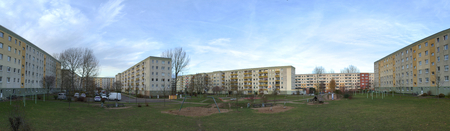 lps: Backyard of Plattenbau complex with playground and parking lot in Greifswald, Germany.