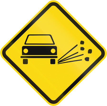 skidding: Loose Chippings warning sign used in Brazil.