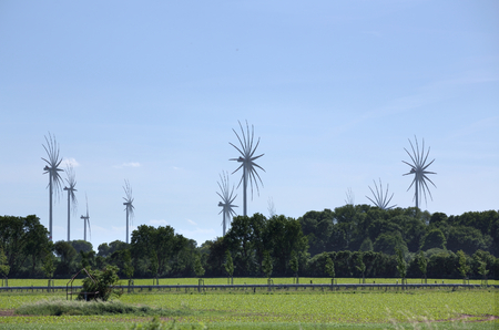 Wind power stations in Mecklenburg-Vorpommern, Germany, with special image processing to emphasize motion.
