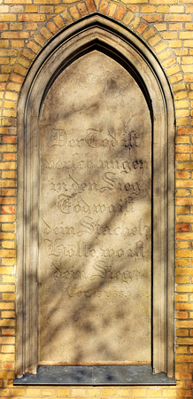 Blind window of the burial chapel in Guetzkow, Mecklenburg-Vorpommern, Germany with bible passage - 1 Corinthians 13:11. Stock Photo