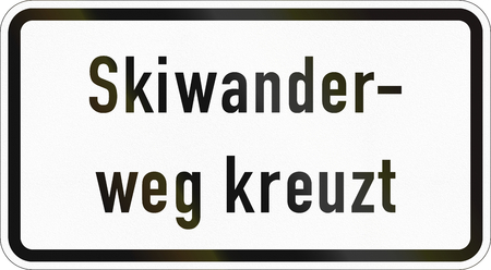 Supplementary road sign used in Germany - Ski trail crossing. Stock Photo