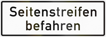 Supplementary road sign used in Germany - Drive on shoulder. Stock Photo