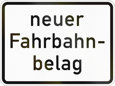 Supplementary road sign used in Germany - New road surface. Stock Photo
