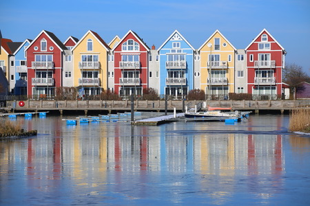 Colorful row of houses at the river Ryck in Greifswald, Germany.