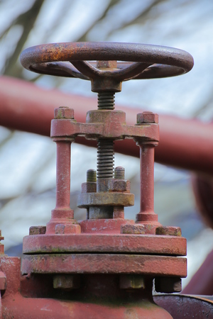 Valve of a historical red steam engine.