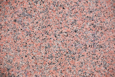Red granite texture with feldspar, quartz, and mica.