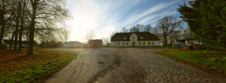 Cobblestone road and historical manor, listed as monument in Dargelin, Mecklenburg-Vorpommern, Germany.