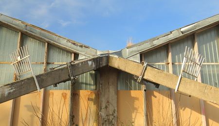 Architectural detail of modern yet ruined roof.