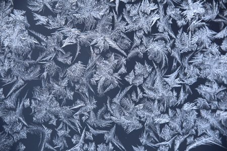 Abstract macro image of window frost flowers.