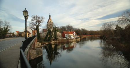 View over Saale river with Church Saint Thomae in Merseburg, Germany.