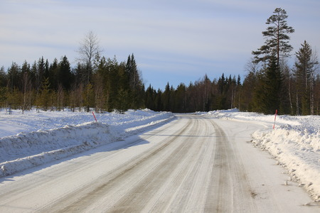 Icy road in northern Sweden during winter.