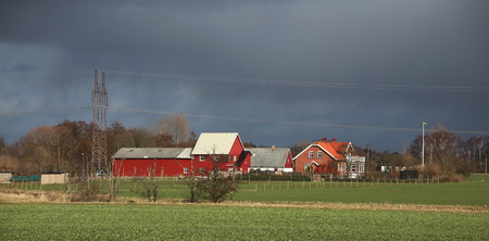 Rural landscape in Scania, Sweden with farm houses. Imagens