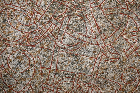 Close up of ornaments from an ancient runestone.