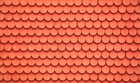 Texture of wooden tiles painted typically Swedish with falu red. Zdjęcie Seryjne
