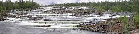 Cascade-like waterfalls at Trappstegsforsen in the stream Kultsjoan in Vasterbotten, Sweden.