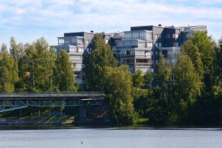 Modern buildings in Skelleftea with bridge and the stream Skelleftealven.