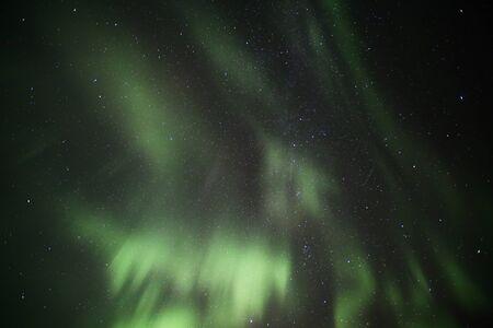 View from below the Northern lights over Scandinavia. Stok Fotoğraf
