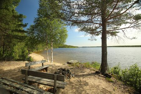 Sand beach at lake Vargforsdammen, a reservoir in the stream Skelleftealven in Northern Sweden. Stock Photo