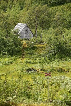 Mountain hut in Blasjofjalls nature reserve near the Wilderness Road in Sweden. Stock Photo