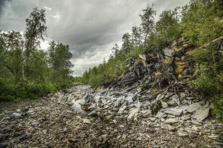 River bed of the stream Renselelva near the cave Marmorgrottan in Norway.