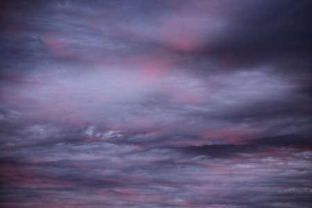 Impressive cloudscape, lightly illuminated by the sun below. Foto de archivo