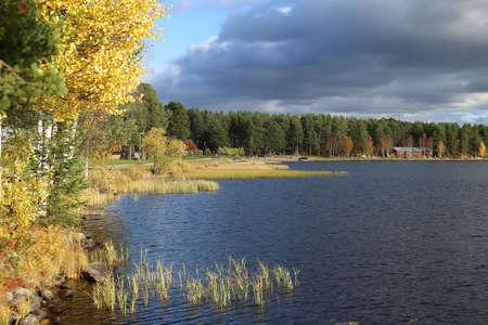 Shore of lake Talvatissjon in Jokkmokk, Sweden.