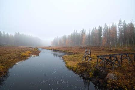 The stream Petikan in northern Sweden in fog.