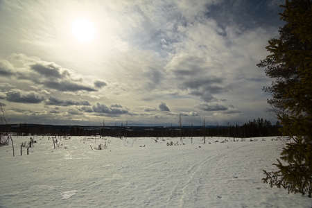 Cloudscape and breakable snow crust near Granbergsliden in Vasterbotten, Sweden.
