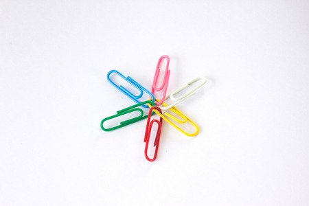 metal fastener: Colored paper clips Isolated on white background