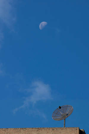 airwaves: satellite dish with white moon