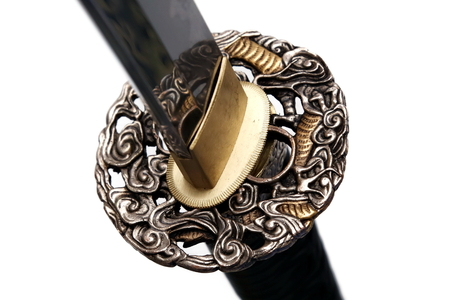 Tsuba : hand guard of Japanese sword with white background Stock Photo