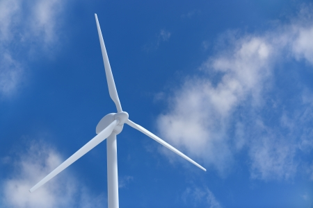 Wind turbine on blue sky photo