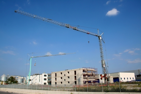 Crane at working, building an house Stock Photo - 16628304