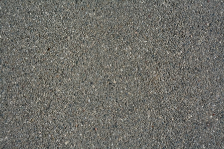 Road background, asphalt macro - grey color