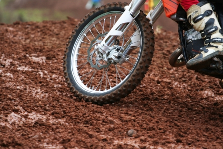 Crop on a motocross wheel during a competition Stock Photo