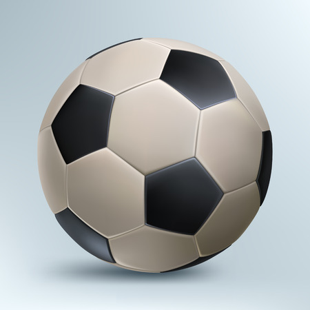 leather football with black polyhedra on a light background