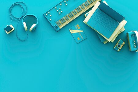 Laptop surrounding by colorful gadgets on blue background. 3d rendering Stock fotó