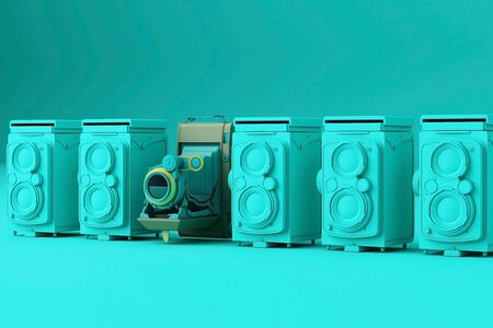 Colorful vintage camera surrounding by green vintage camera on a green background. 스톡 콘텐츠