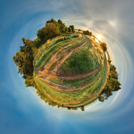 Green little planet with trees and field. Tiny planet with blue sky and sun. 360 viewing angle.