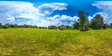 3D spherical panorama with 360 viewing angle. Ready for virtual reality or VR. Full equirectangular projection. Cold blue sky with green grass and with some trees at summer.